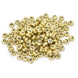 Guldfärgade bokstavspärlor