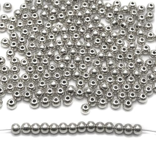 Runda silverfärgade metallpärlor på 4mm