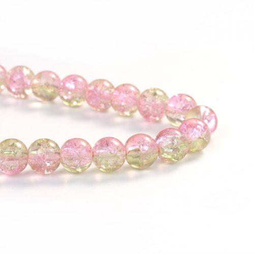 Rosa/grön crackle glaspärlor på sträng.