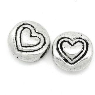 Metall pärla med hjärta