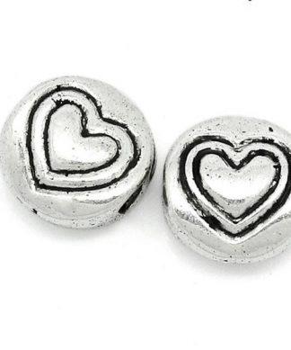 Metallpärlor hjärtan med graverad hjärtan